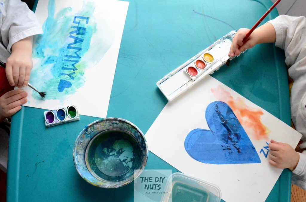 preschooler hands painting grammy and heart easy watercolor paint project