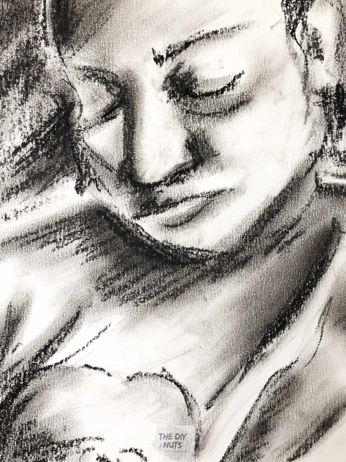 Charcoal drawing of mother and daughter