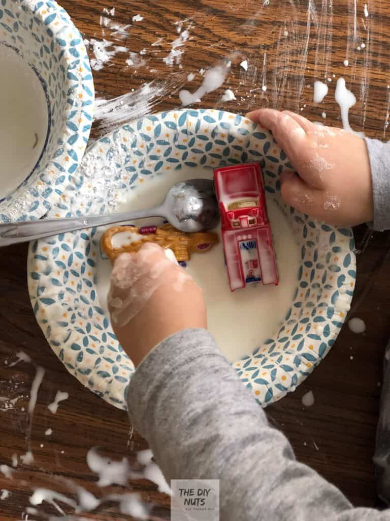 Toddler playing in Easy DIY Oobleck Slime