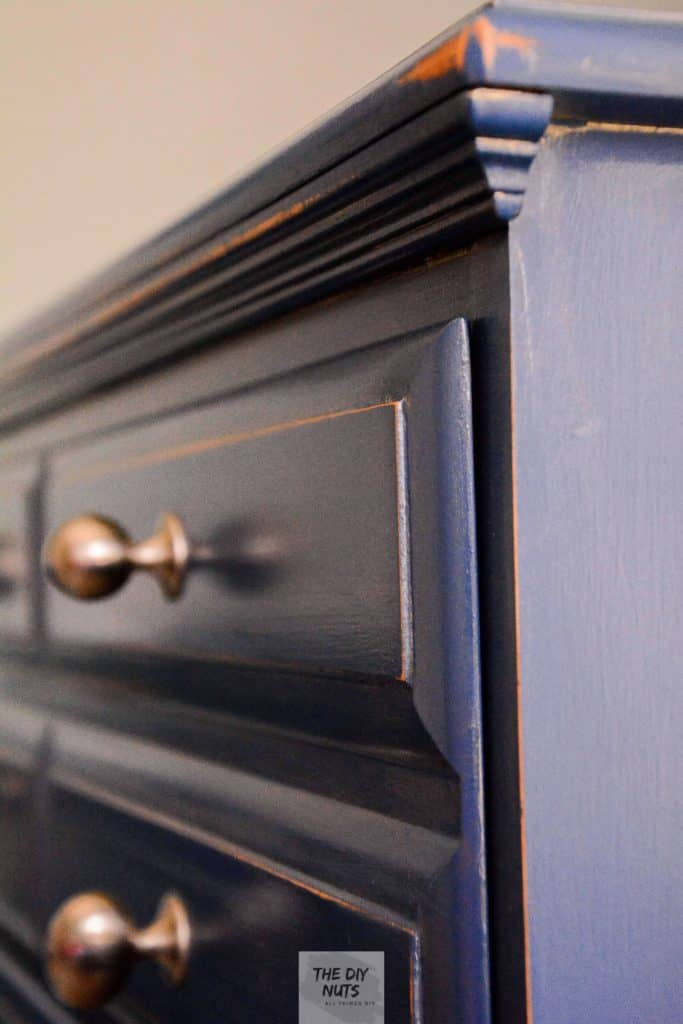 Close-up view of distress blue dresser painted with chalk paint