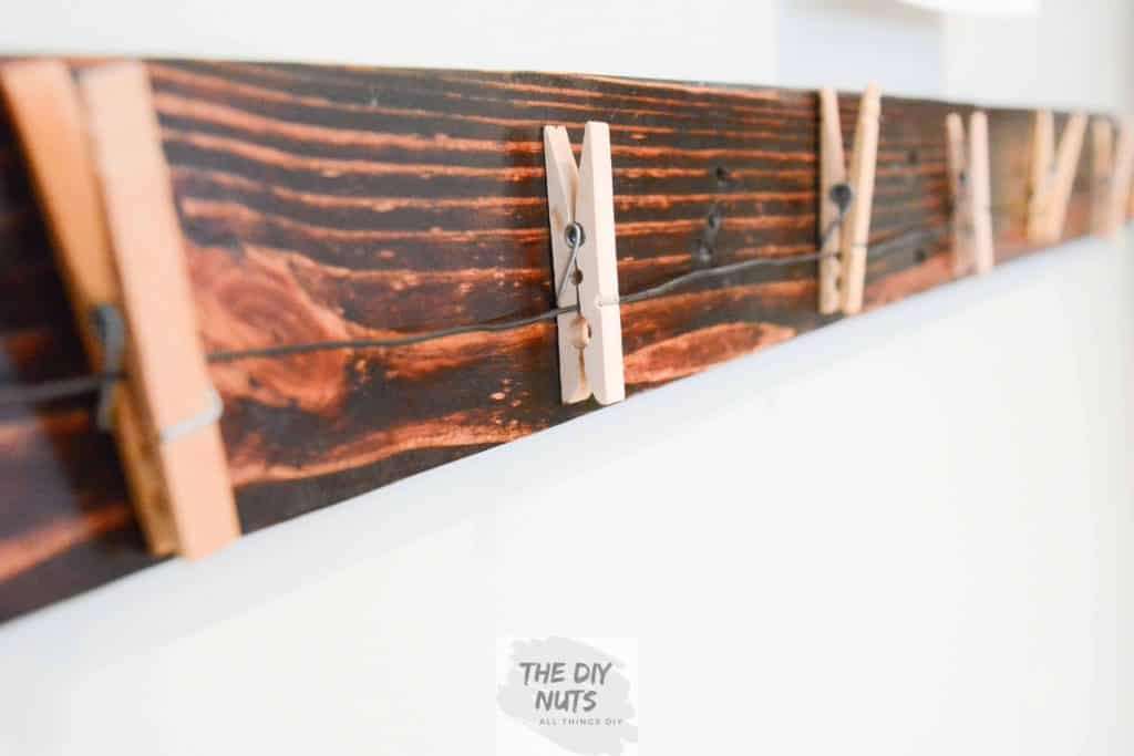 Stained Pallet Wood with Clothespins and wire for display
