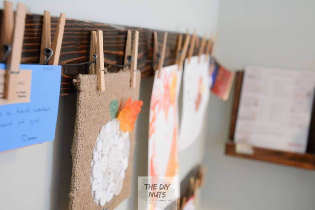 Stained Pallet Wood with Clothespin displaying toddler and kid art projects