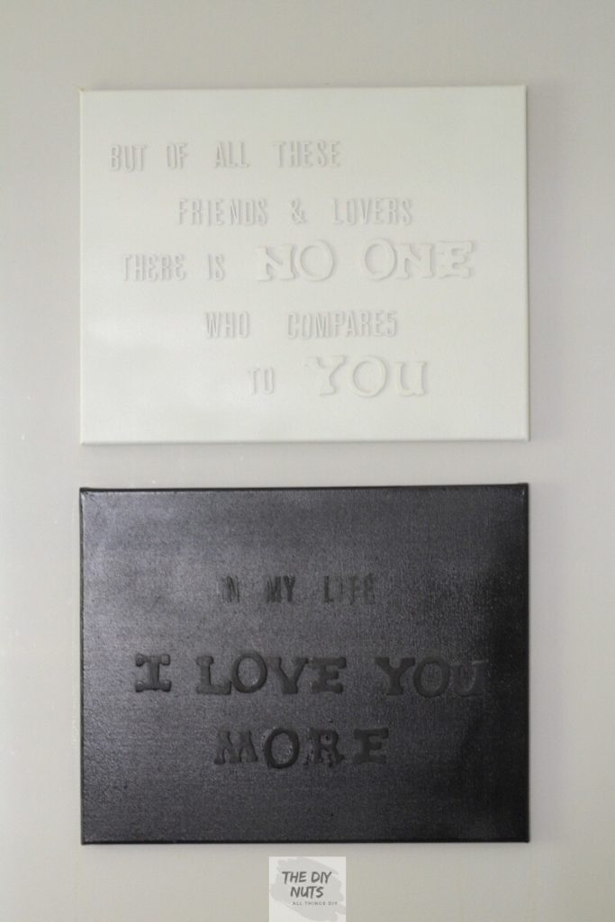 Black and white word art canvases made with wooden letters and spray paint