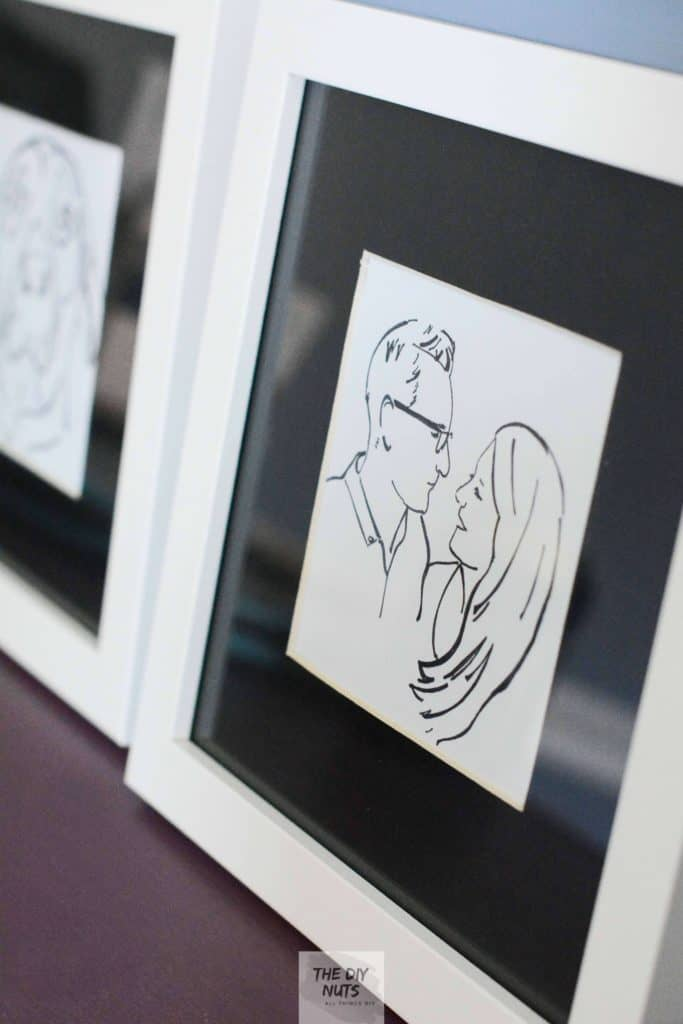 Two framed black and white artworks in white frames for a wedding gift.