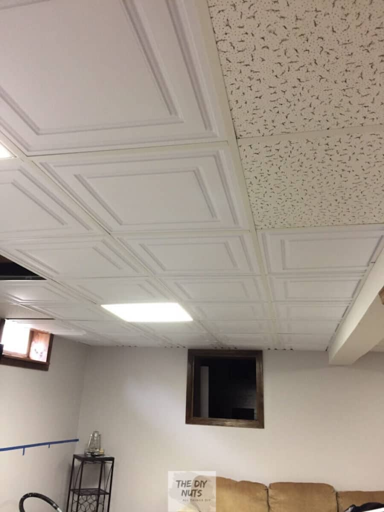 The difference between old drop ceiling tiles and new celiume stratford vinyl tiles in basement makeover