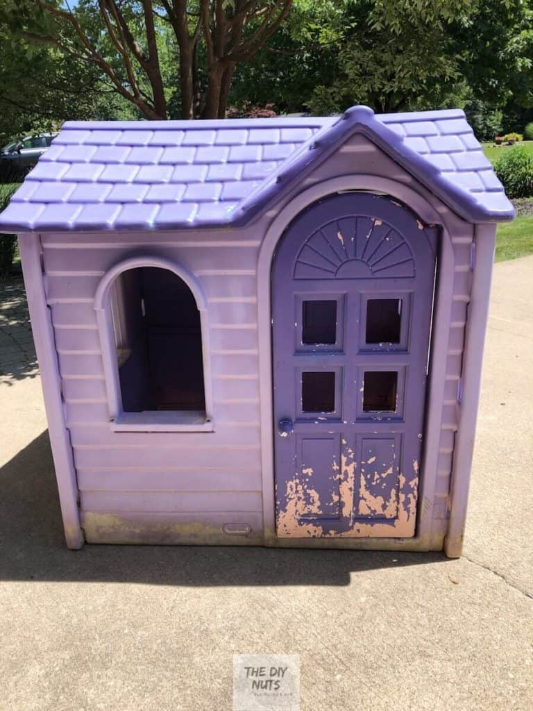 Before DIY playhouse makeover of a purple little tykes house that has chipped paint