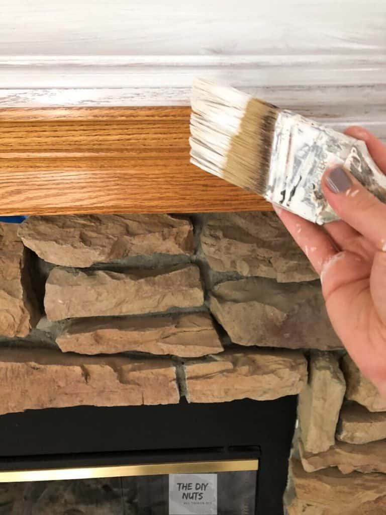 Begin using primer to paint mantle to redo fireplace
