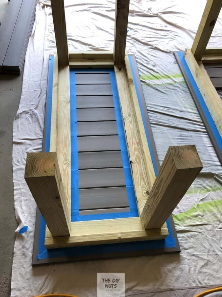 Blue painter's tape used to separate pressure treated wood outdoor table base and composite decking table top