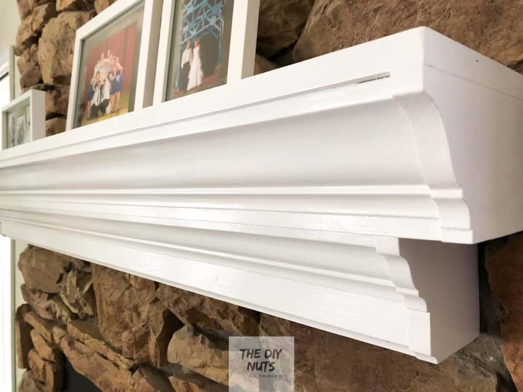 White painted mantle in DIY fireplace update