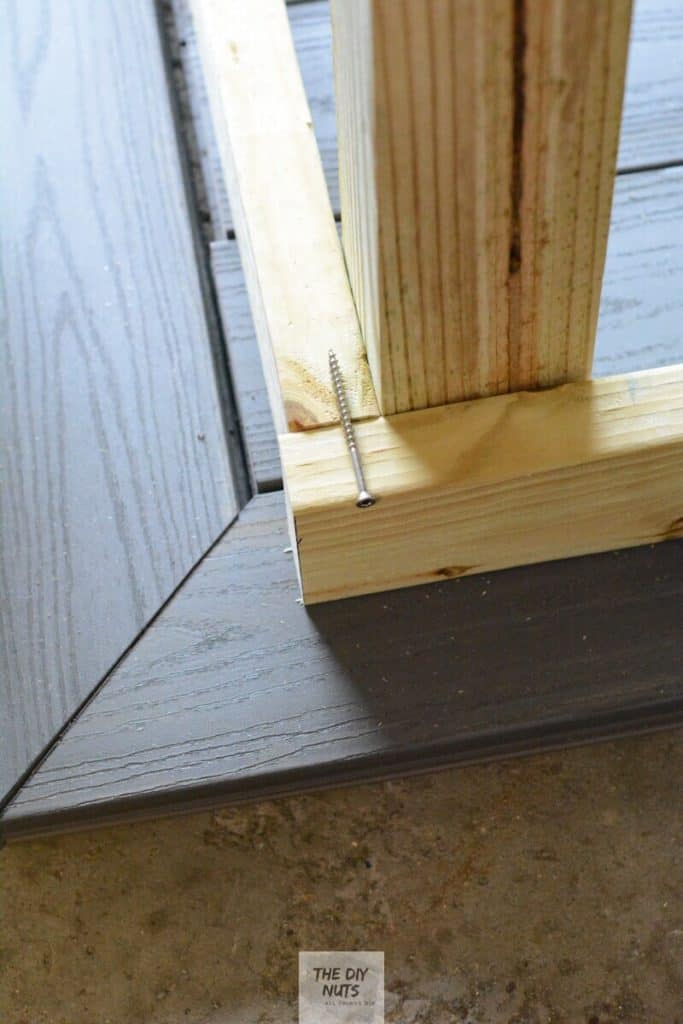 Long galvanize screw used to attach pressure treated wood post to outdoor wood table