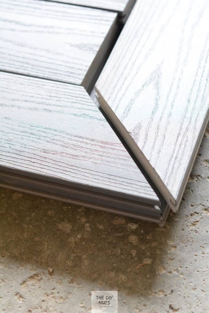 Mitered gray composite decking used to create DIY outdoor table