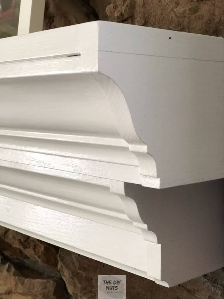 Two coats of white latex enamel paint for DIY fireplace update