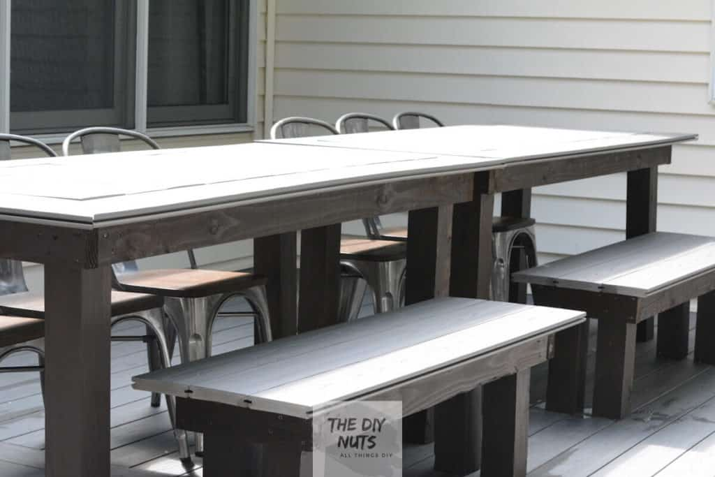 Gray DIY outdoor dining table and benches made with leftover composite decking