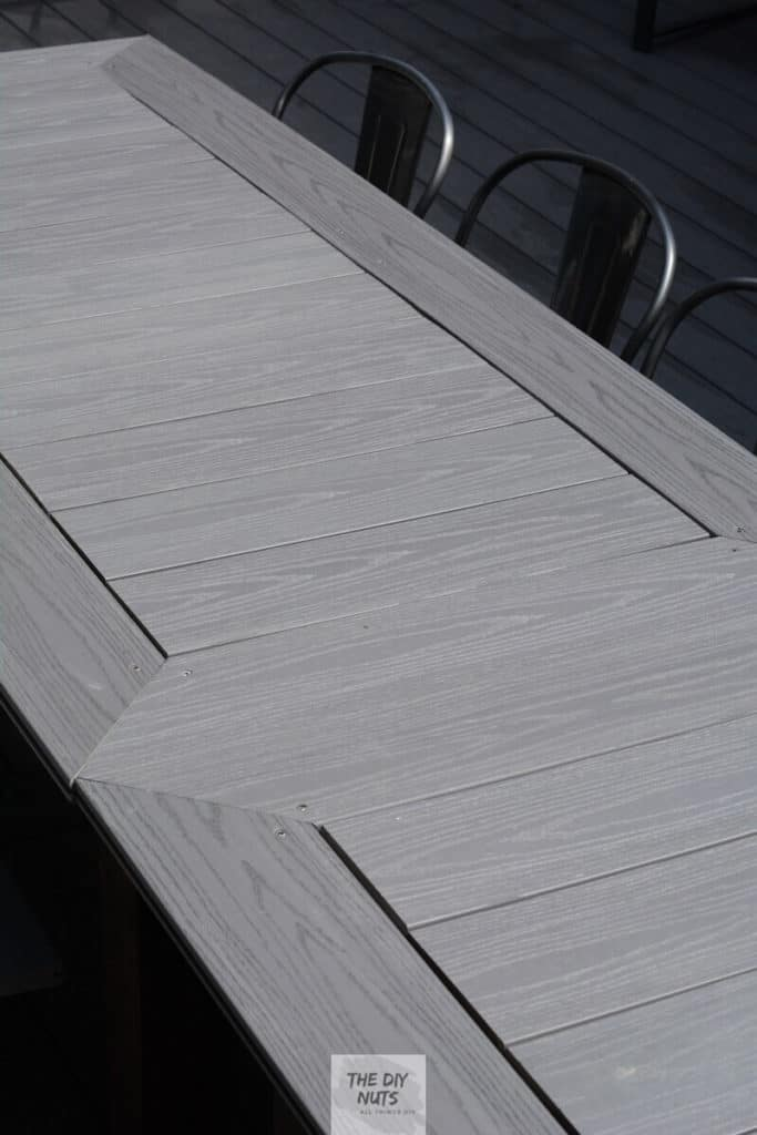 Gray composite decking top  of a DIY outdoor dining table