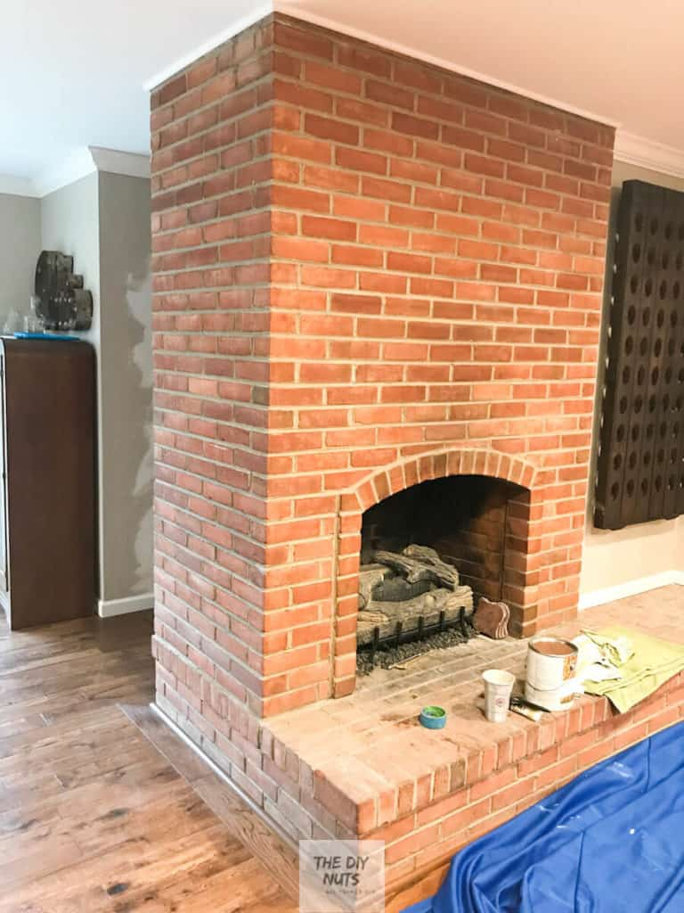 Brown/red Brick fireplace before fireplace makeover
