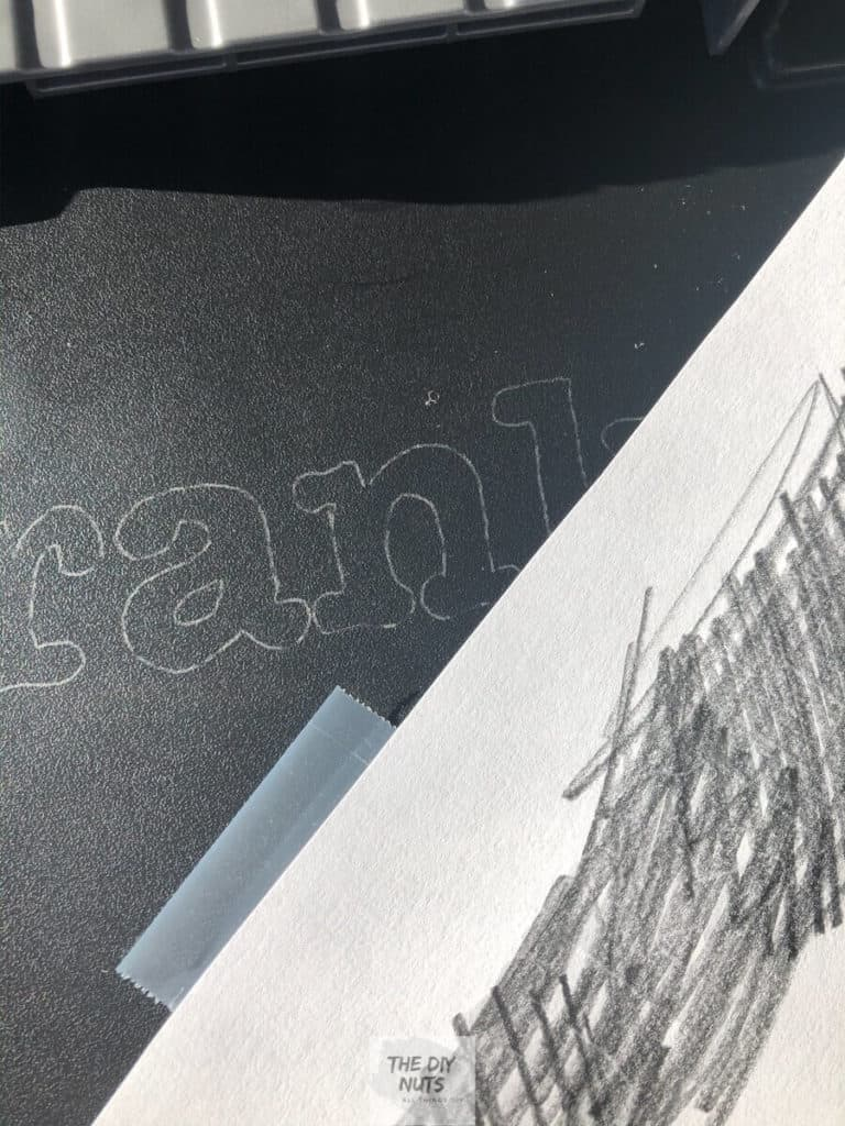 Graphite on the back of paper after drawing transfer technique for lettering