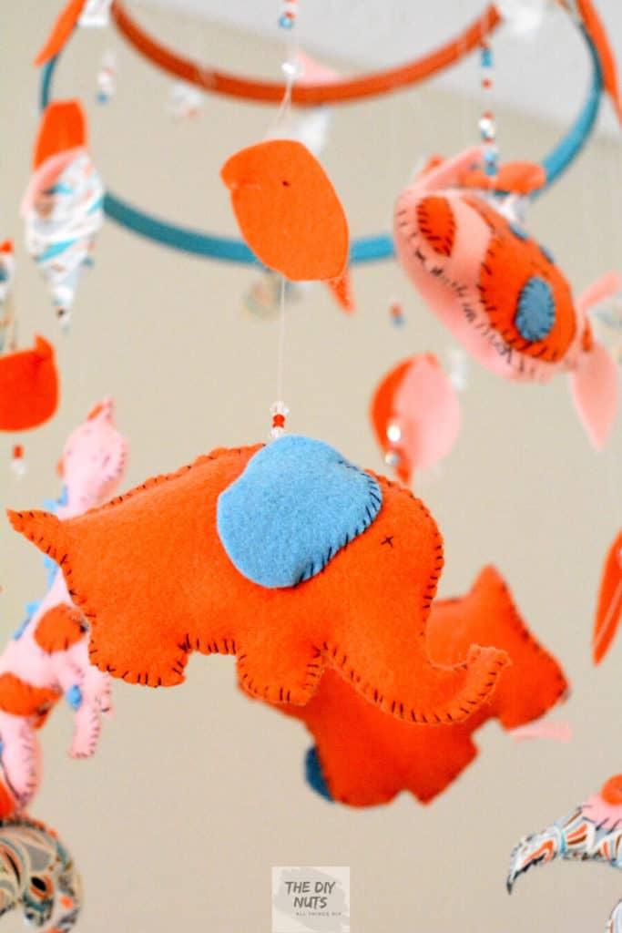 Orange and Teal Felt jungle animals made into a DIY baby nursery mobile
