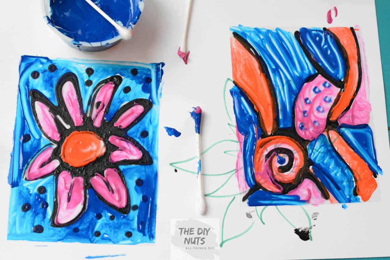 Painted transparency with colored q-tips to create a DIY stained glass art project for kids