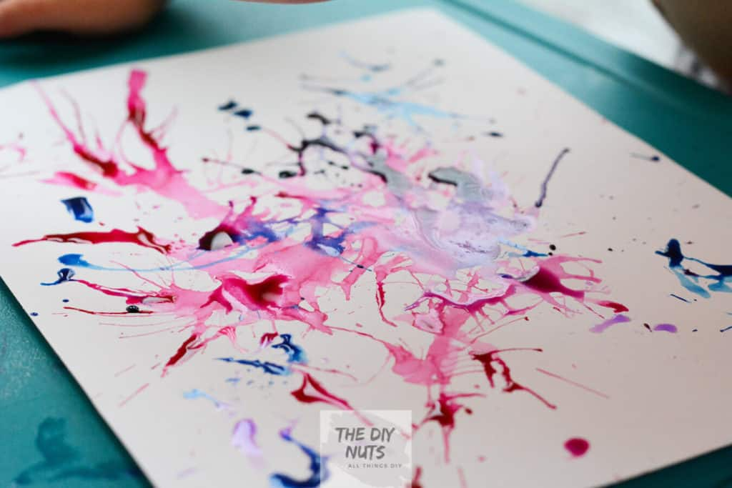 Pollock Inspired Watercolor Painting done with liquid watercolor paint and straw by 4-year-old boy