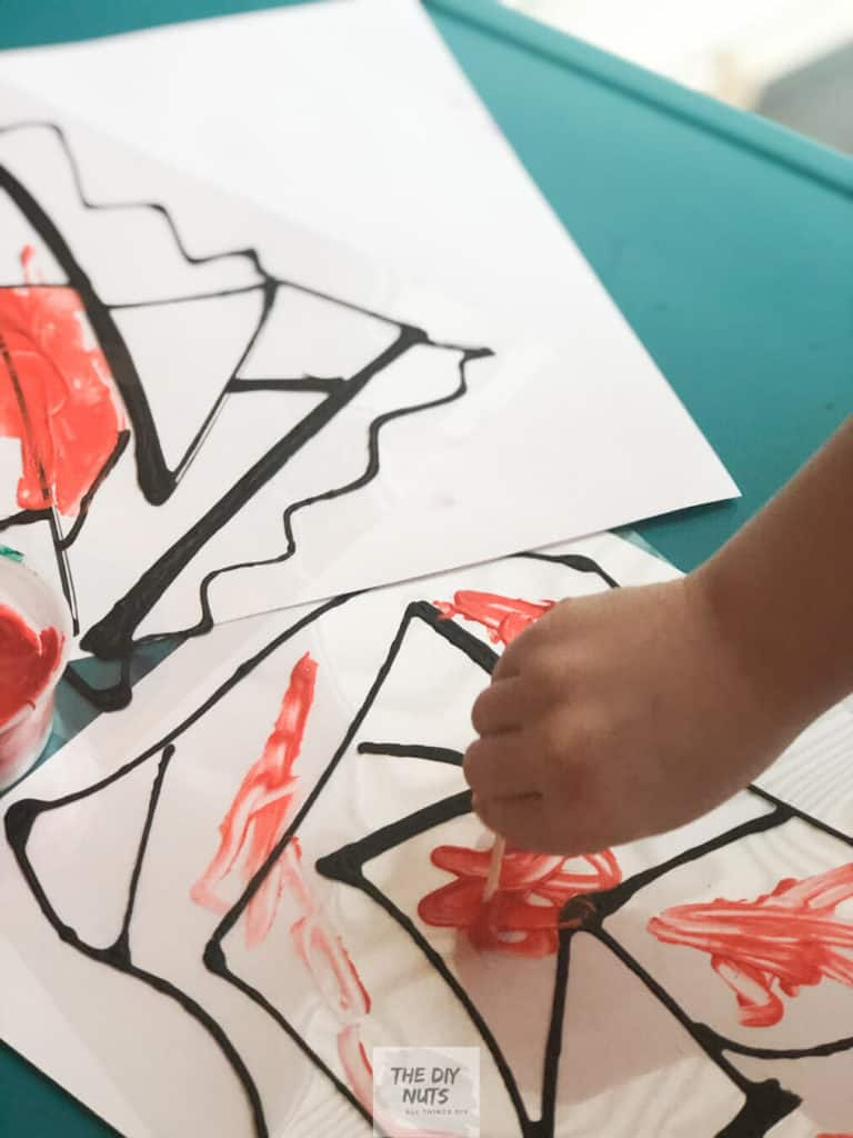 4-year-old creating a faux stained glass window