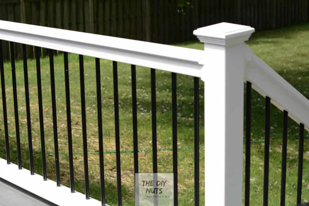 White vinyl railing with black metal spinders