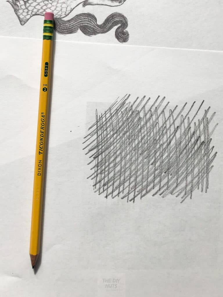 Putting pencil on the back of drawing