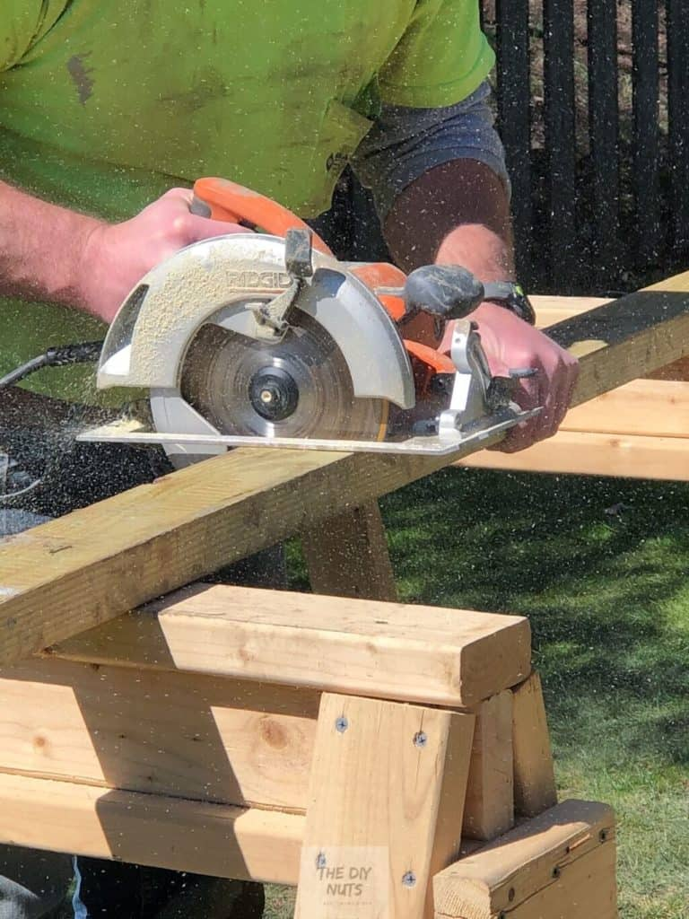 Circular saw cutting 2 x 4's for rock wall