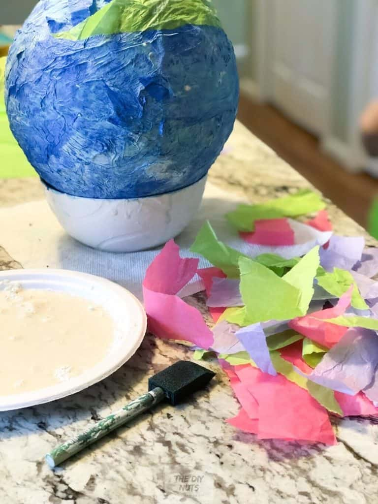 Colored Tissue paper added to homemade DIY pinata