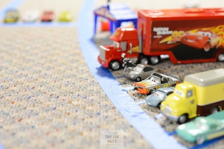DIY racetrack for kids with painter's tape and toy cars