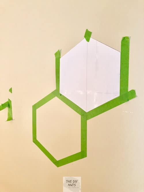 Frog tape around hexagon template for painted accent wall