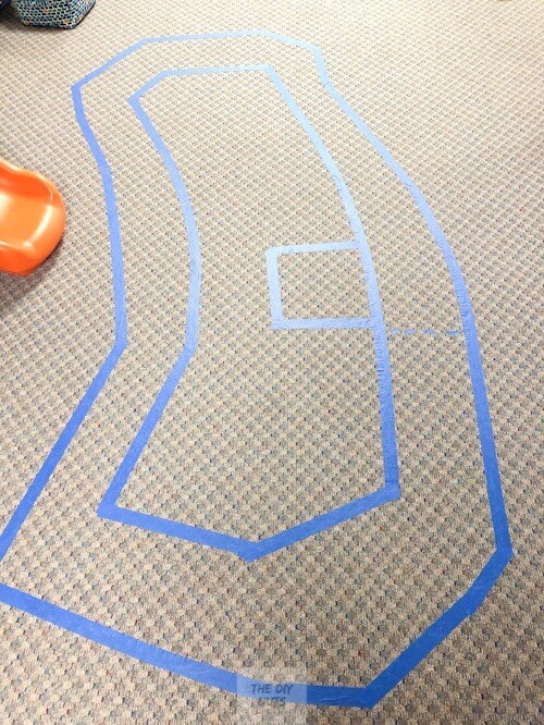 Painter's tape to make a racetrack for kids