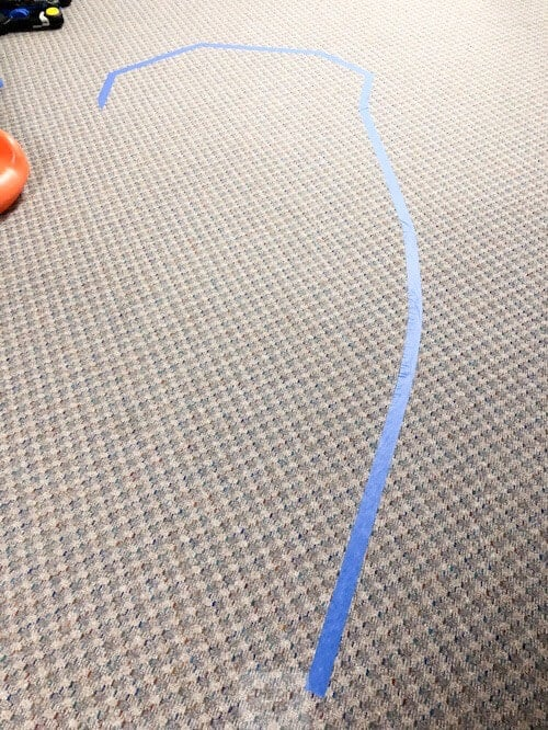 Carefully tape out racetrack on floor