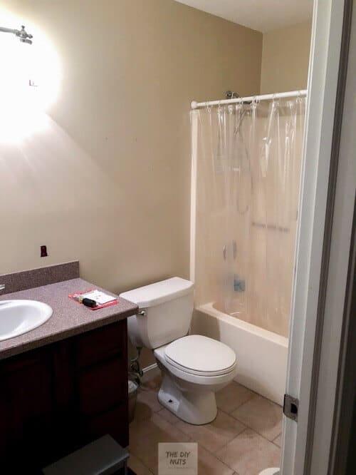 Beige hallway small bathroom