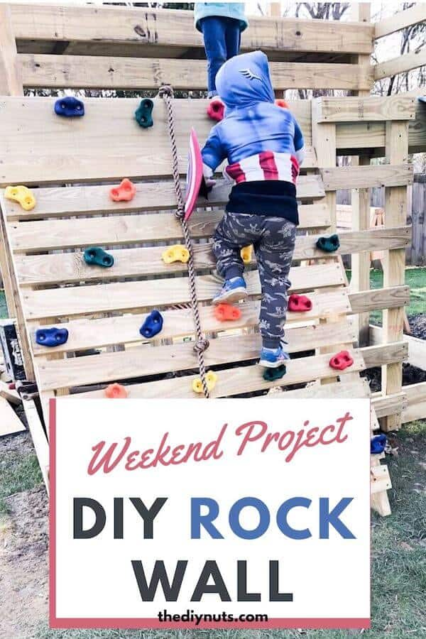 Boy climbing DIY rock wall