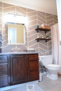 Gray herringbone painted accent wall in bathroom