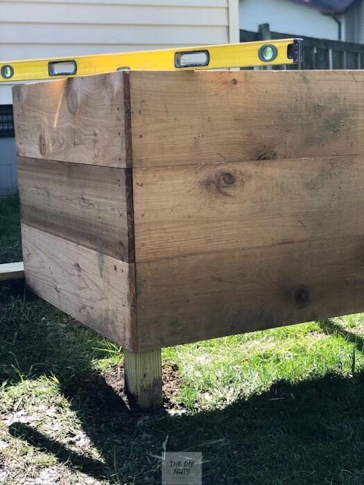 Raised planter box in holes