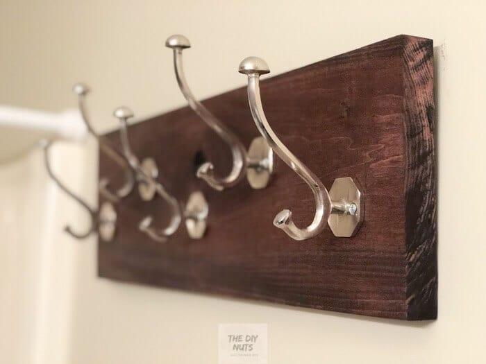 DIY hooks on wood in small bathroom