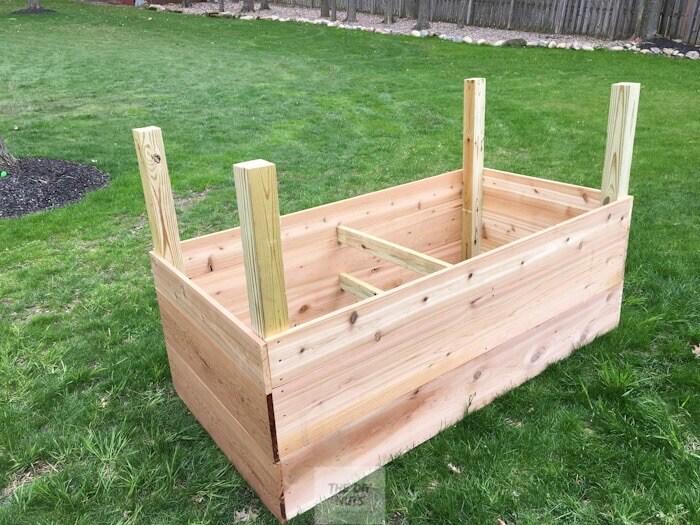 Post sticking up on raised planter box