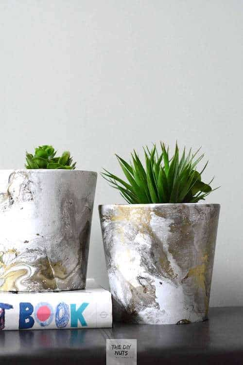 white and gold faux marbled pots with green plants
