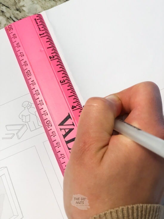 Ruler used to mark nail spot on frame paper
