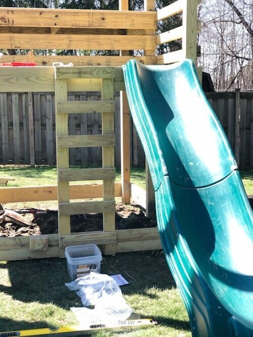 Attaching slide to wooden playset