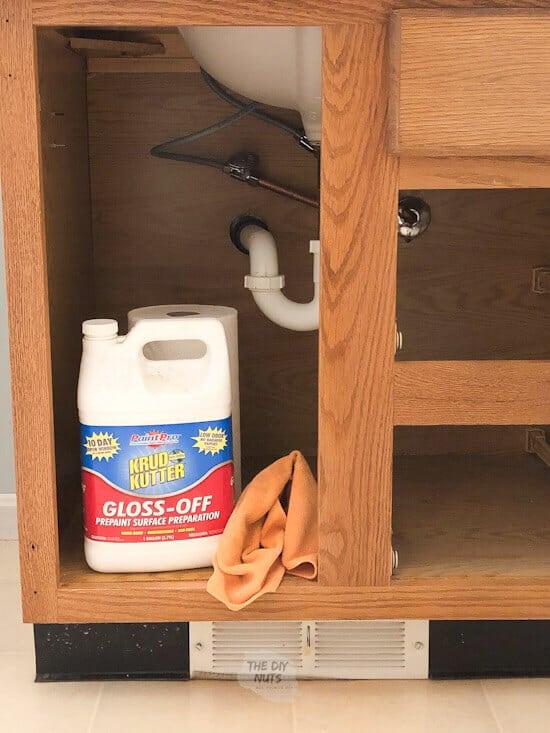 Use a deglosser before priming oak cabinets