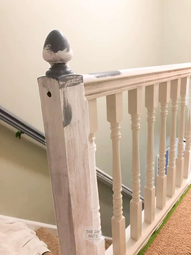 Oak banister being painted two colors