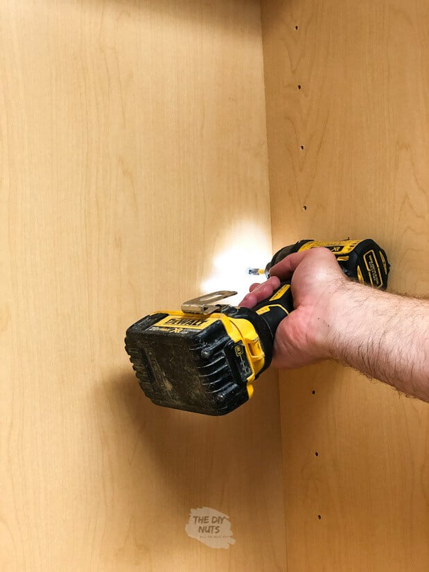 Attaching laundry room cabinets with drill