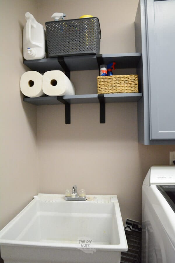 DIY laundry room shelves over utility sink