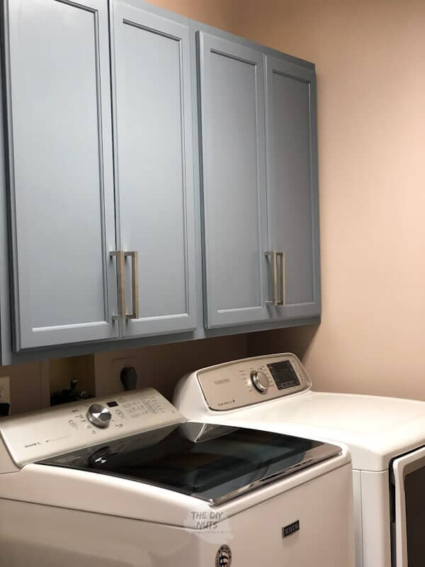 Gray-blue laundry room cabinets