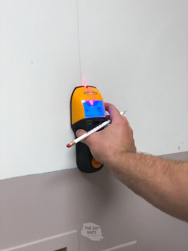 Stud finder used for laundry cabinet installation