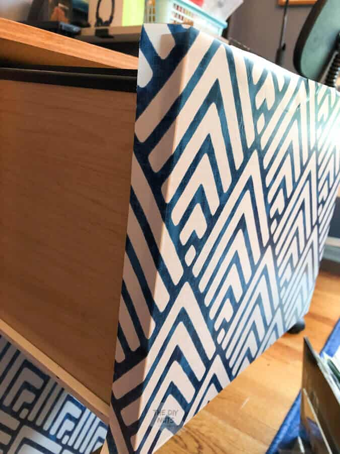 Wrap contact paper around file cabinet drawer