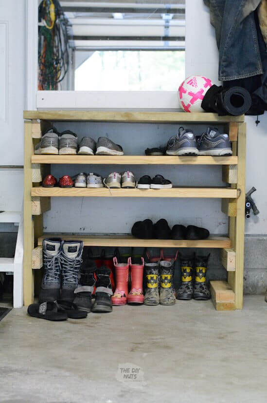 DIY wooden shoe rack in garage