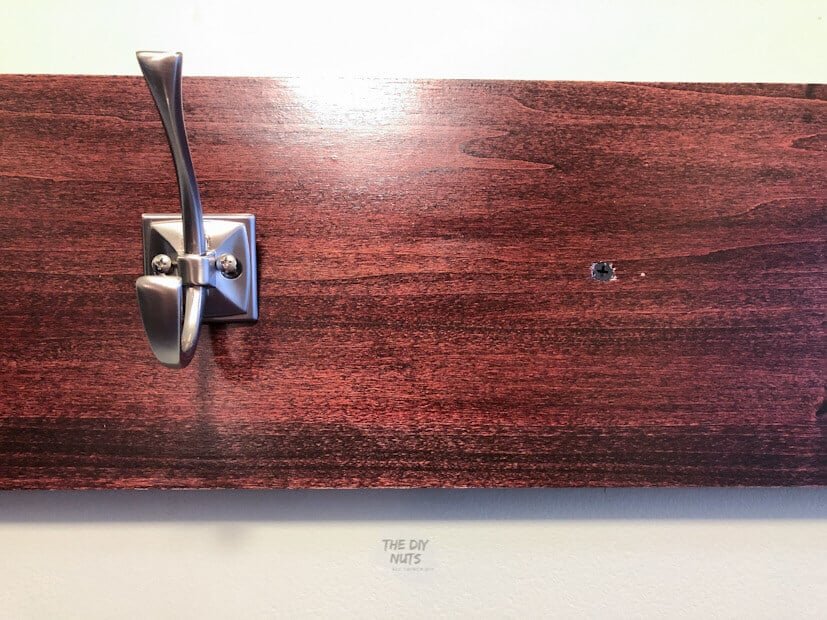 Silver Wall hook on stained board